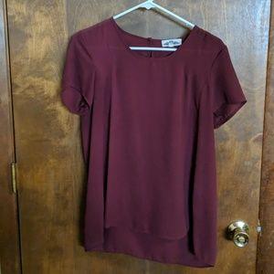 Burgundy short sleeve blouse.